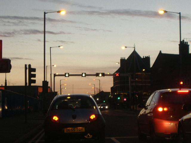 File:The Queens Road Tidal Flow system on the A61 in Sheffield. OK, it's a slightly dark photograph, but the lighting effects on it just seemed great in my humble opinion. The sunset was great that day. - Coppermine - 4607.jpg