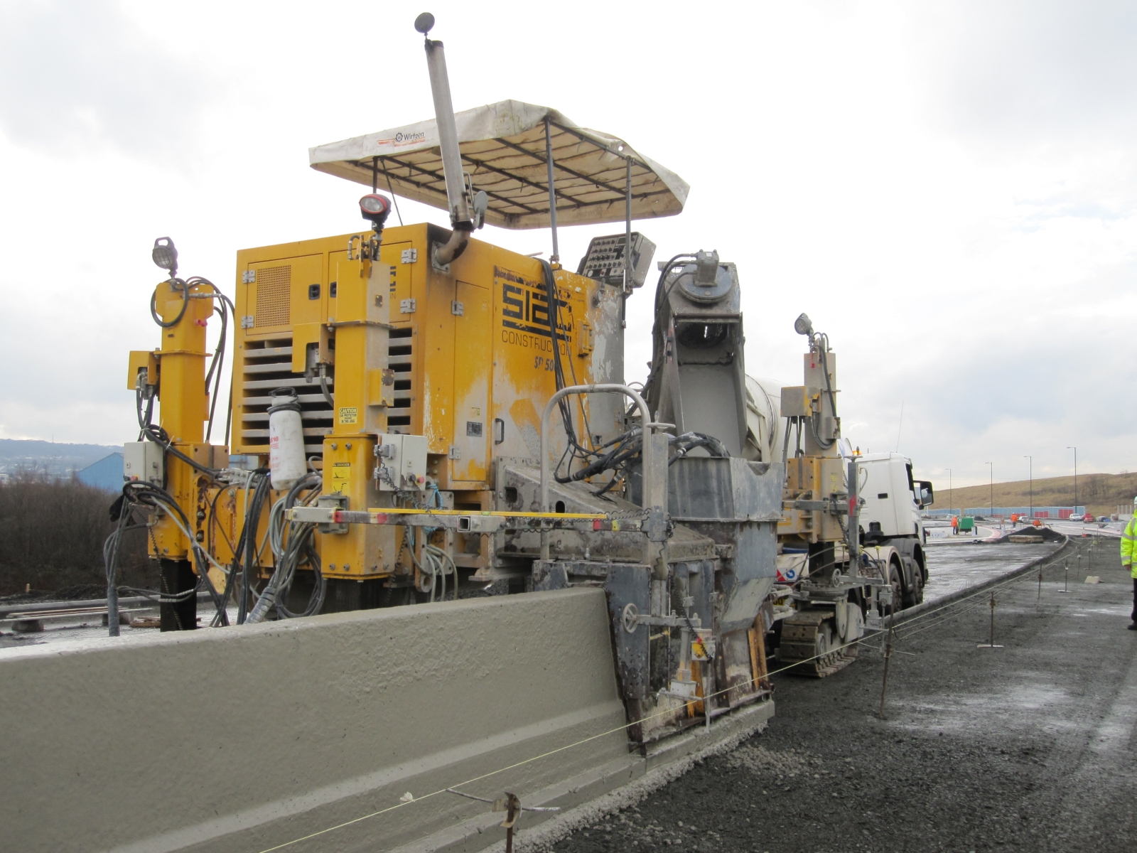 File m concrete barrier slipform g roader s digest