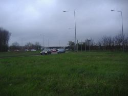 Grass lane divider on the A5 roundabout Fenny Stratford - Geograph - 2882487.jpg