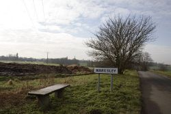 Bench next to dung heap, Waresley, Cambridgeshire - Geograph - 331376.jpg