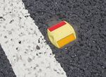 Yellow and red road stud.jpg
