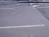 Damage to road at speed hump - Coppermine - 5105.JPG