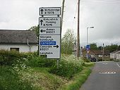 Signs at Kirkpatrick Fleming mini-roundabout - Coppermine - 13675.JPG