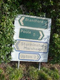 Corfe Mullen- old and even older sign at Jubilee Cross - Geograph - 1122756.jpg
