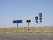 20170919-1950 - Collection of signs, Texas 35.2112353N 101.3646232W.jpg