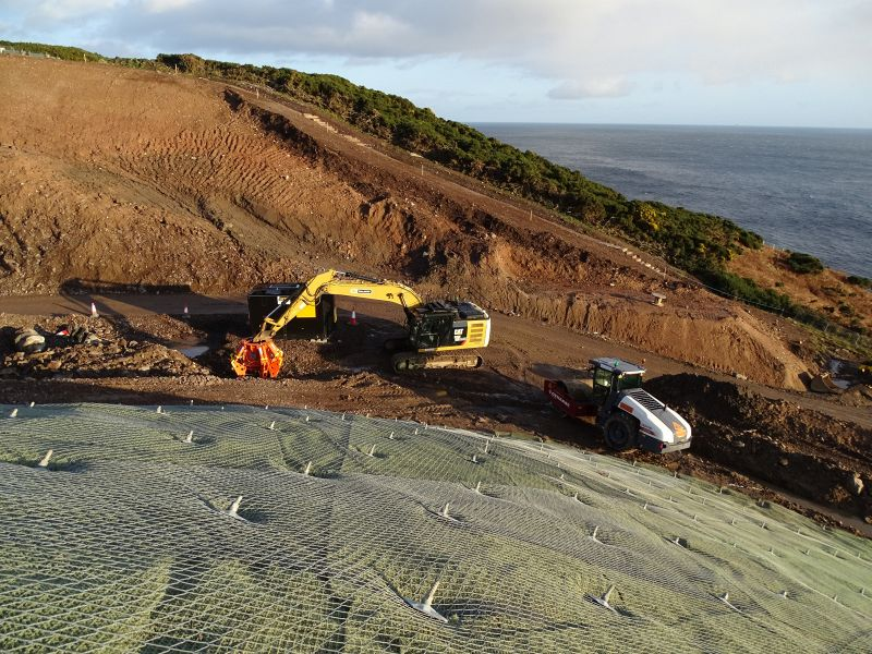 File:A9 Berriedale Braes Improvement - Slope netting and excavator.jpg