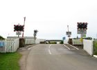 Level crossing and entrance to... (C) Colin Bell - Geograph - 853756.jpg