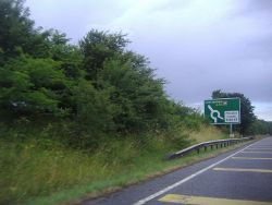 The A40 approaching Asthall Barrow - Geograph - 3575709.jpg