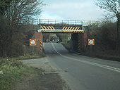 The railway crosses the A429 - Geograph - 1107594.jpg