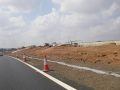 20180714-1002 - Heading south on new A50 sliproads - construction to right to take new Sb free flow sliproad onto M1, crossing M1 offslip to Kegworth Interchange 52.851014N 1.295583W.jpg