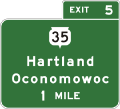 Wis-sth-35-hartland-oconomowoc-advance-guide-sign-fictitious.png