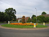 Leicester Lane roundabout in bloom in July.jpg