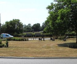 Shepherd and sheep statues on a roundabout near Bicester - Geograph - 4562012.jpg